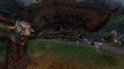 Lord of the Rings Online - Enedwaith tribal kook fighting a warg.