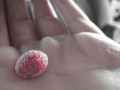 Sour red skittle I took a pic of.