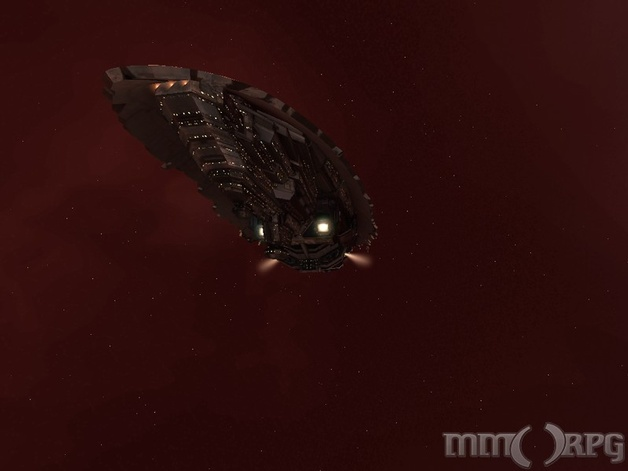 amarr freighter passing a nebula