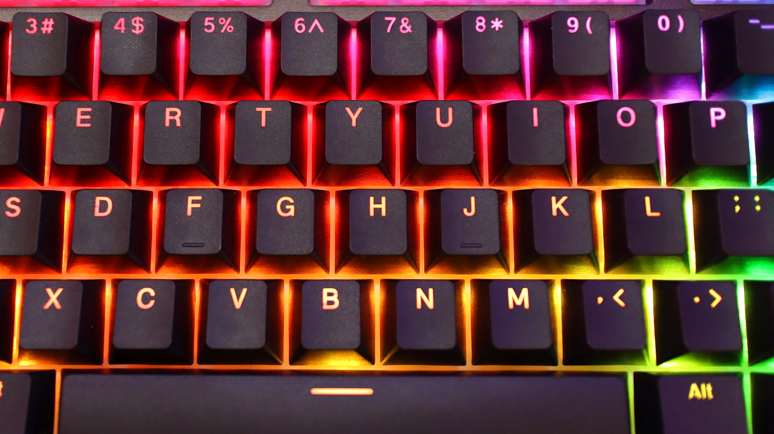 A white panel spreads RGB lighting evenly under the keys